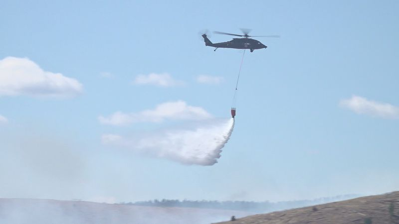 Black Hawk Helicopter dropping water on Schroeder Fire