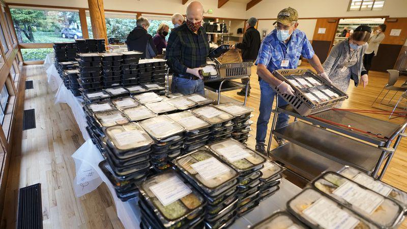 Meals on Wheels volunteers sort prepared meals prior to deliver to seniors, Wednesday, Dec. 9,...