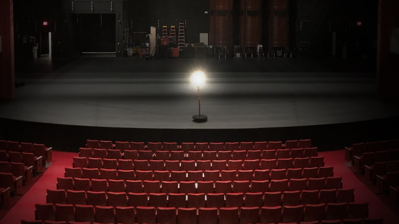 A ghost light sits on the stage at the Fox Cities Performing Arts Center while the theater...