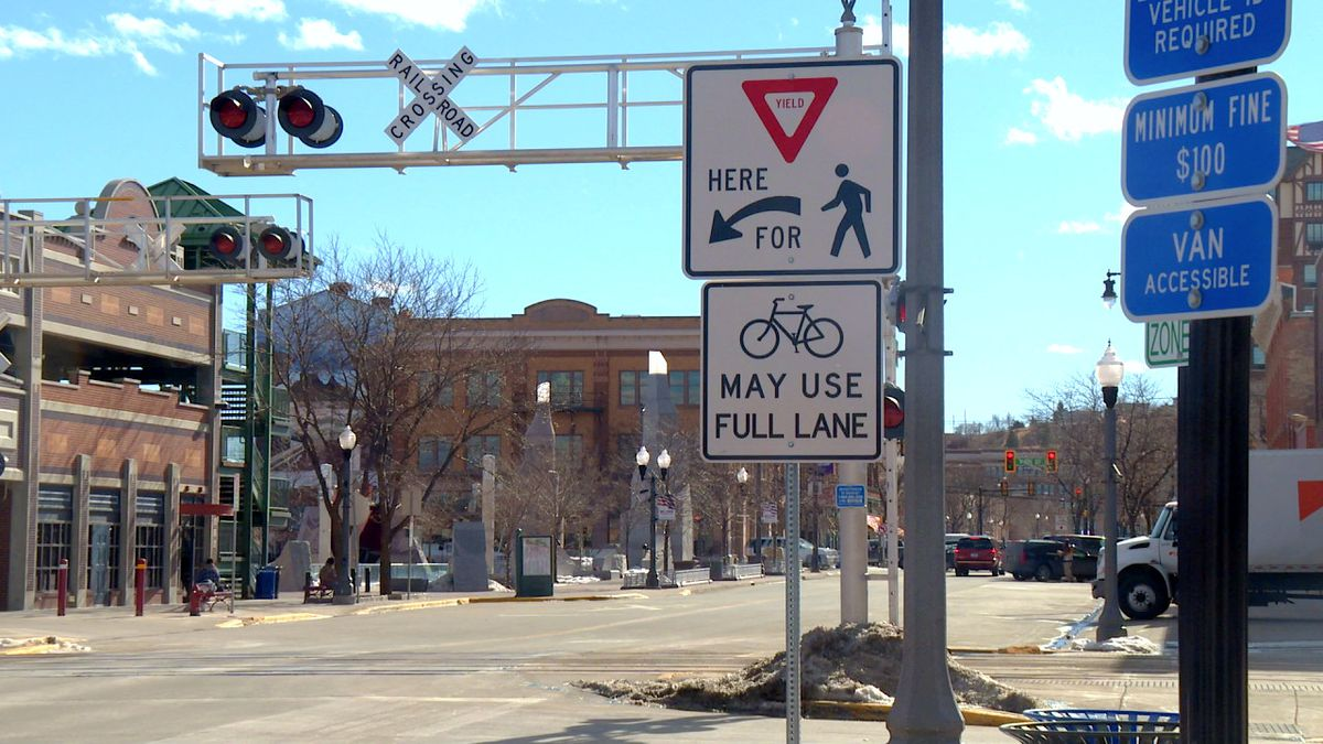 A road sign on near Main Street Square indicates bicyclists can travel throughout downtown...