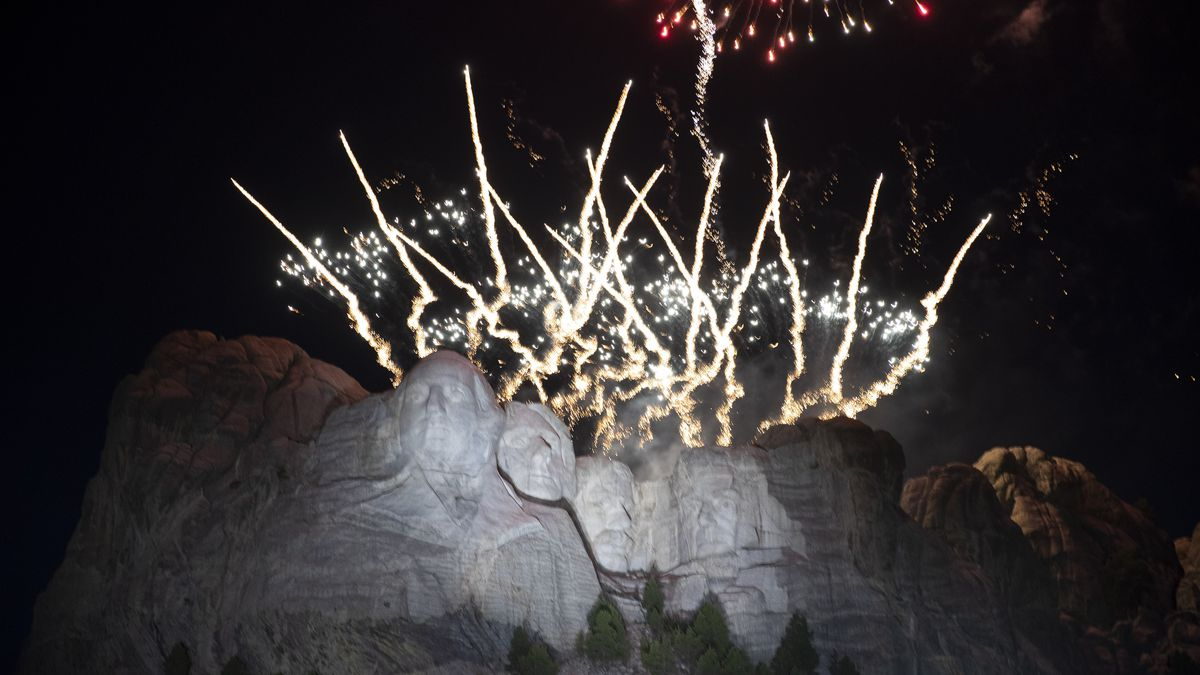 Fireworks light the sky at Mount Rushmore National Memorial, Friday, July 3, 2020, near...