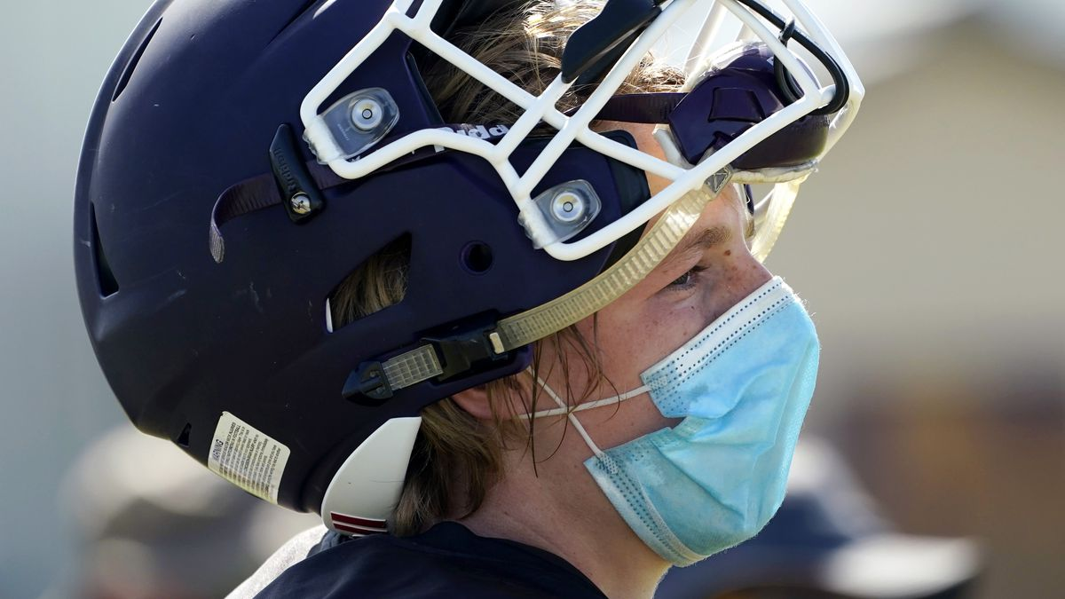Thrall High School football player Hayden Stefek wears a face mask as he goes through a practice, Thursday, Aug. 13, 2020, in Thrall, Texas. Coronavirus testing in Texas has dropped significantly, mirroring nationwide trends, just as schools reopen and football teams charge ahead with plans to play.