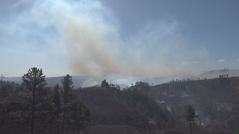 As the fire continues to burn, more than 2100 acres, only 50 percent contained, two residents...