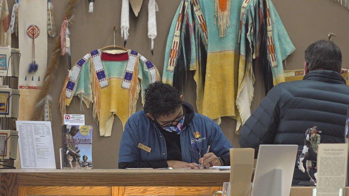 An employee at Prairie Edge is helping a customer.