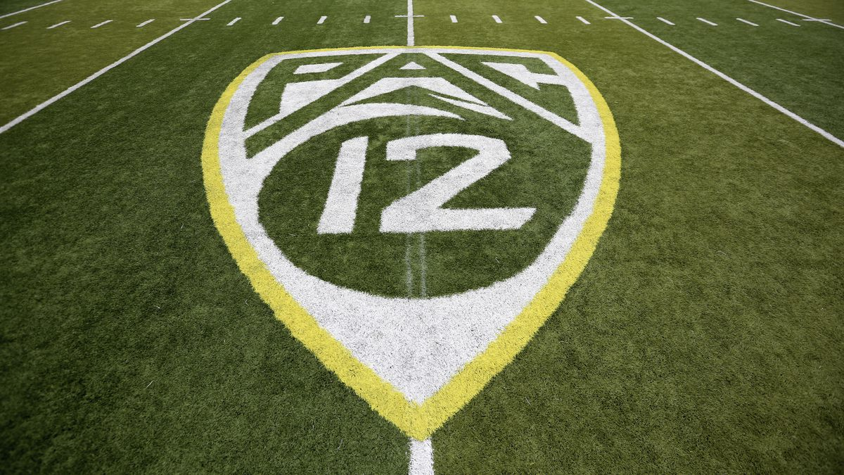 In this Oct. 10, 2015, file photo, a PAC-12 logo is displayed on the field before an NCAA...