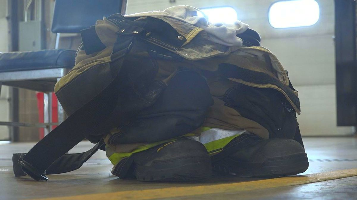 A Rapid City firefighter's uniform is left beside a fire engine at the main headquarters. (KOTA TV)