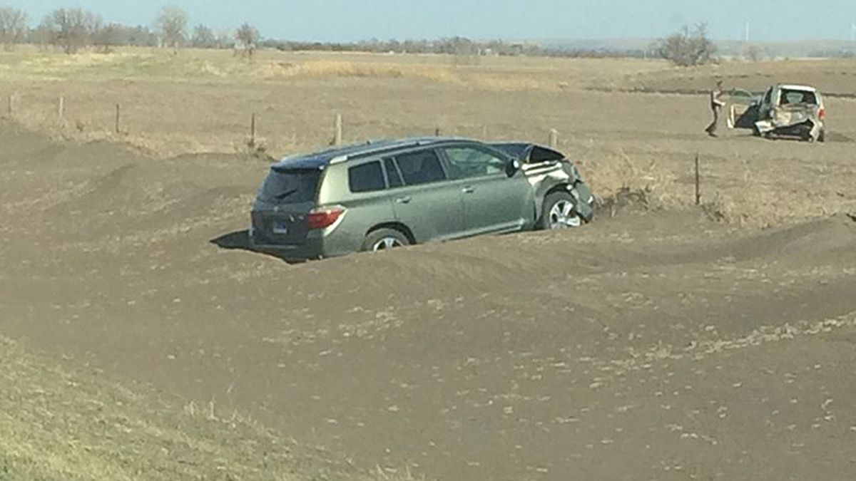A foot of dirt drifted around this vehicle after it crashed in a dust storm Sunday. (photo...