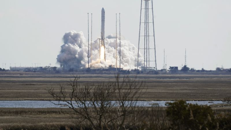 Northup Grumman's Antares rocket lifts off the launch pad at NASA's Wallops Island flight...