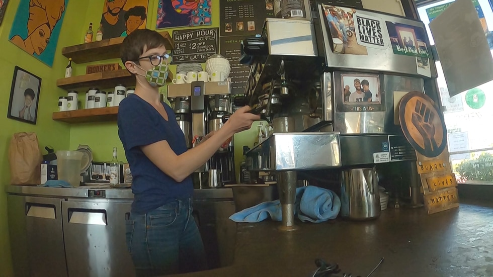 An employee makes a drink at Brewer's Cafe in Richmond, Va.