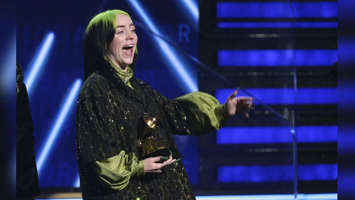 "Billie Eilish accepts the award for record of the year for ""Bad Guy"" at the 62nd annual Grammy Awards on Sunday, Jan. 26, 2020, in Los Angeles. (Source: Matt Sayles/Invision/AP)"
