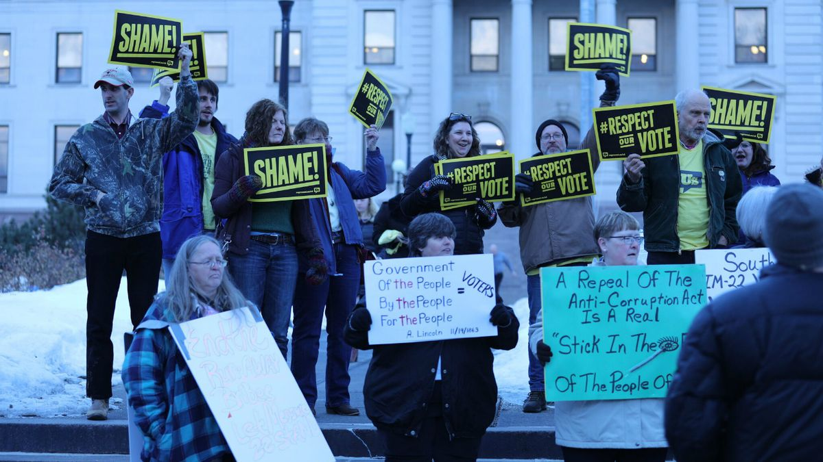 Supporters of Initiated Measure 22 protest in front of the South Dakota capitol building...