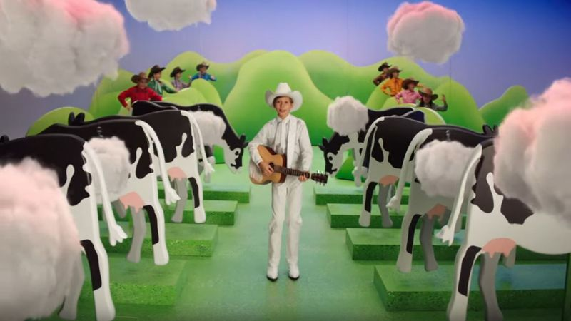 """Walmart yodeler"" Mason Ramsey walks through a cartoonish pasture while flanked by farting..."