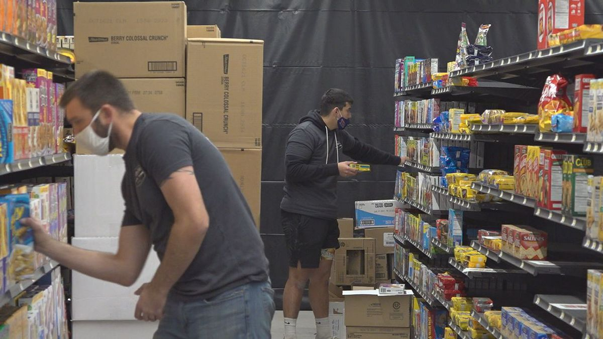 Staff is stocking the shelves at the new store in Box Elder.
