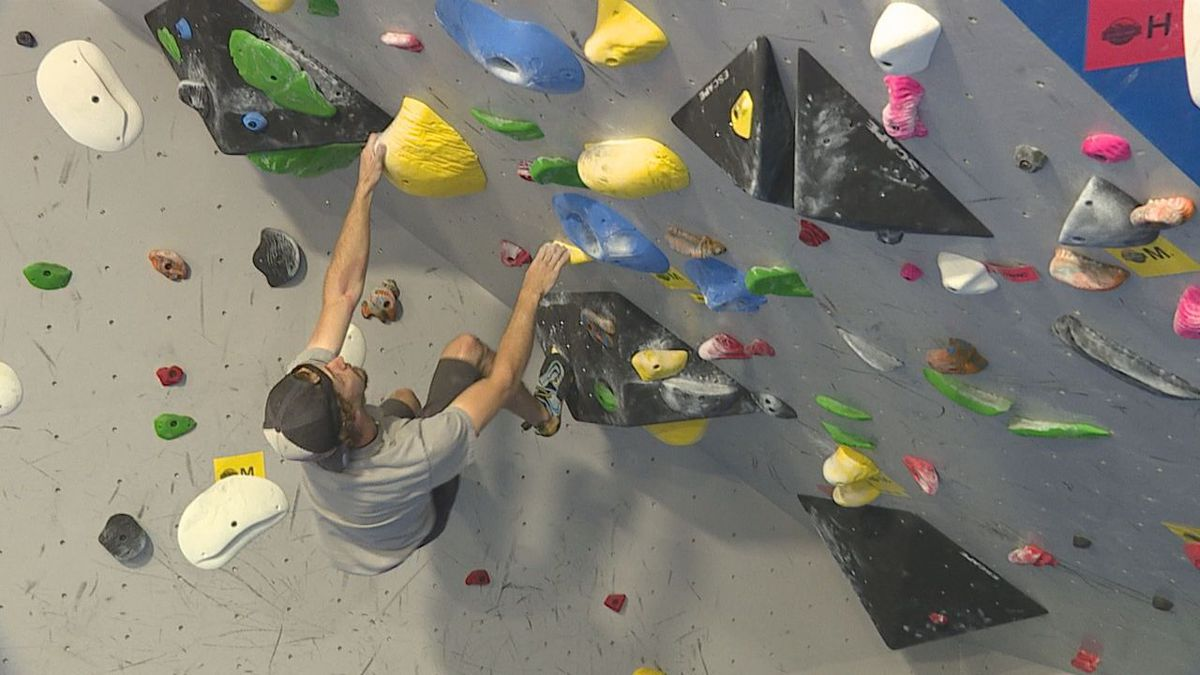 Andrew Bellisle, one of the owners of Black Hills Basecamp climbs a route in his gym.