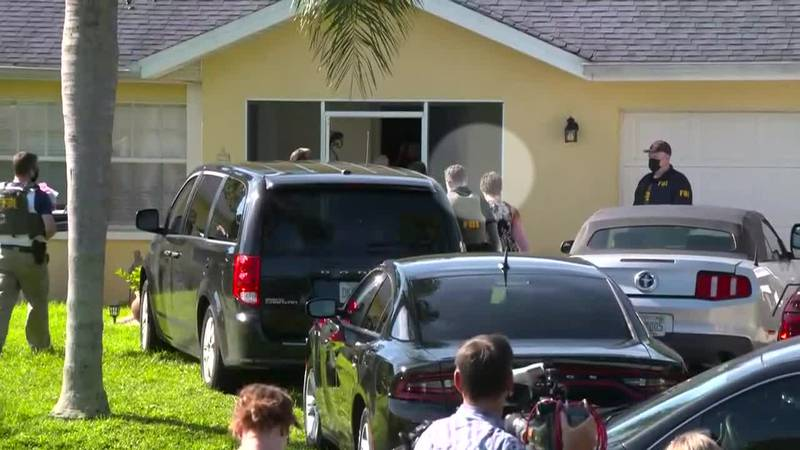 The parents of Brian Laundrie are seen getting out of an FBI vehicle and getting back in their...