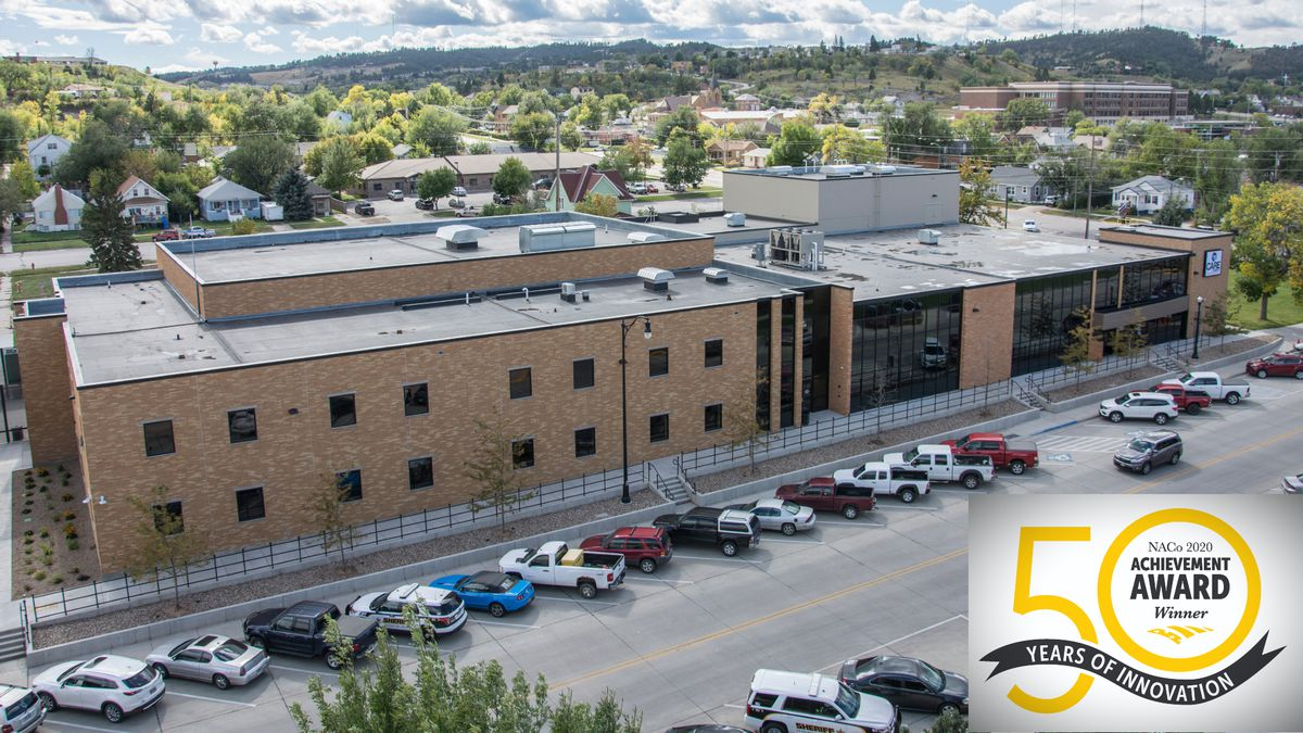 The award honors innovative, effective county government programs that strengthen services for residents. (Photo of Care Campus & graphic of the award logo courtesy of the Pennington County Sheriff's Office)