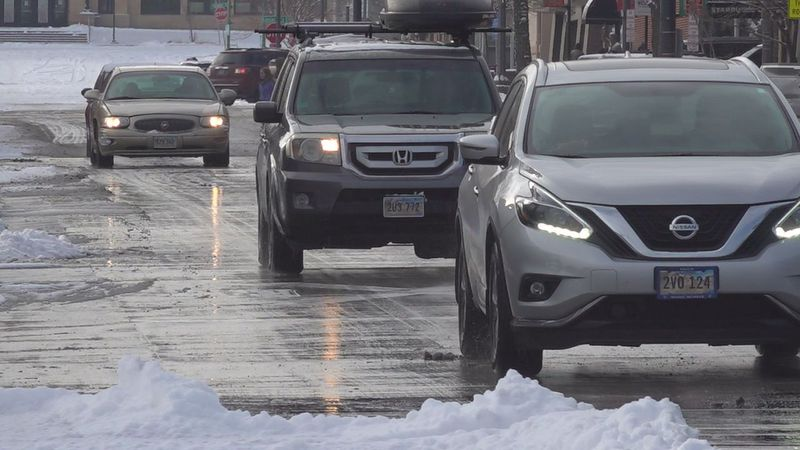 Vehicles driving on clear roads in downtown Rapid City.