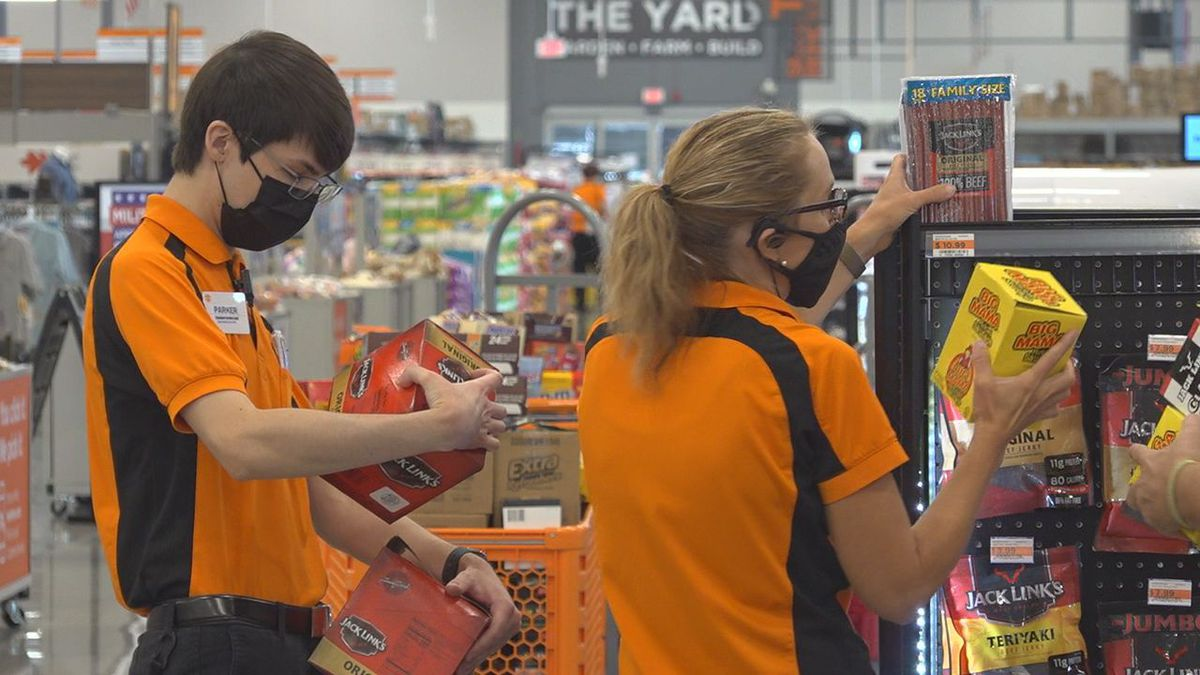 Workers at Fleet Farm are getting the store ready to open.