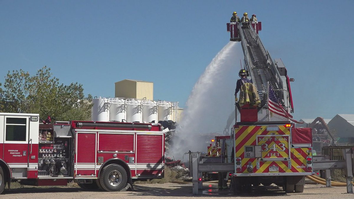 Rapid City firefights putting out scrap fire by putting lots of water.