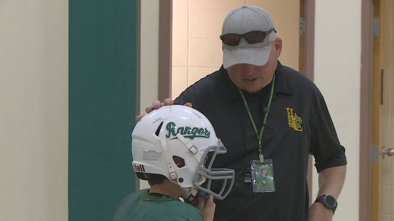 Isakson works with defensive players for the JV Rangers