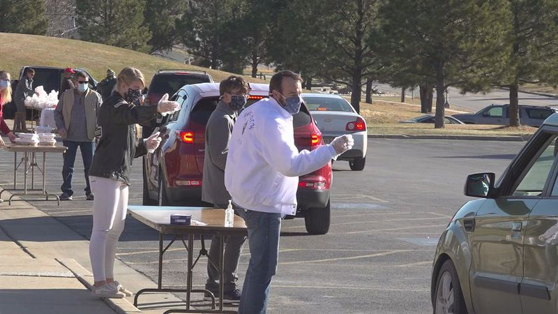 Thanksgiving meals being handed out at St. Thomas More in Rapid City.