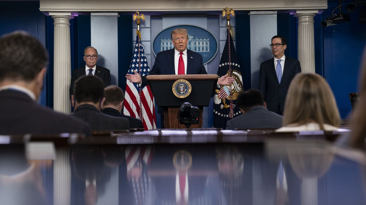President Donald Trump speaks during a news briefing at the White House, Thursday, July 2, 2020, in Washington, as White House chief economic adviser Larry Kudlow, left, and Treasury Secretary Steven Mnuchin, look on. (AP Photo/Evan Vucci)