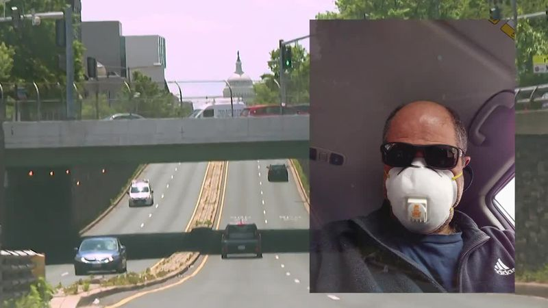 Michael Slie, an Uber driver in Washington D.C, masks up for a day of work during COVID-19....