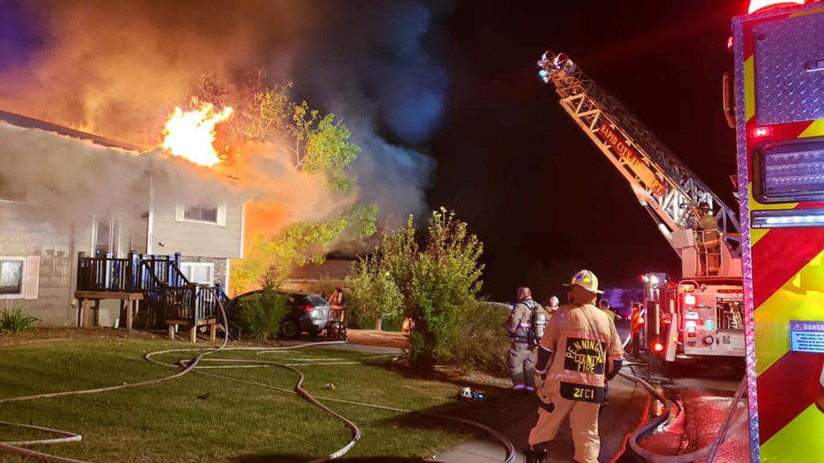 Firefighters respond to a house fire in the early hour of Sunday morning in Black Hawk, S.D.