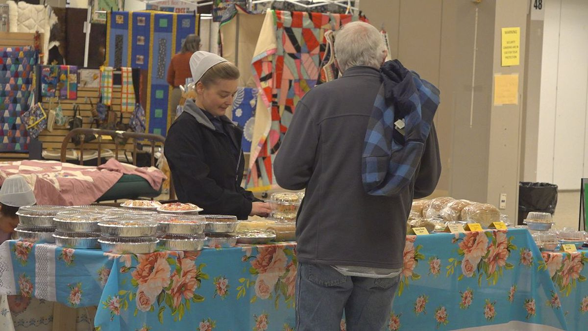 Helping customers at the Traders Market.