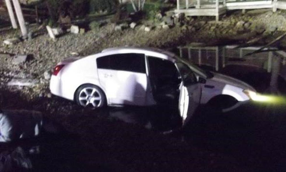 On October 15th at around 6:25 p.m., police were dispatched to 150 N. Lacrosse Street for a report of a vehicle that had just driven into the pond at the attraction. On arrival, police located the vehicle which was partially submerged in the water.