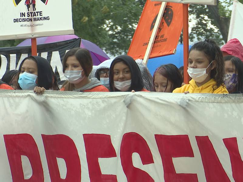 Marching from Steamboat Park to north to the capitol, protesters called for proposed education...