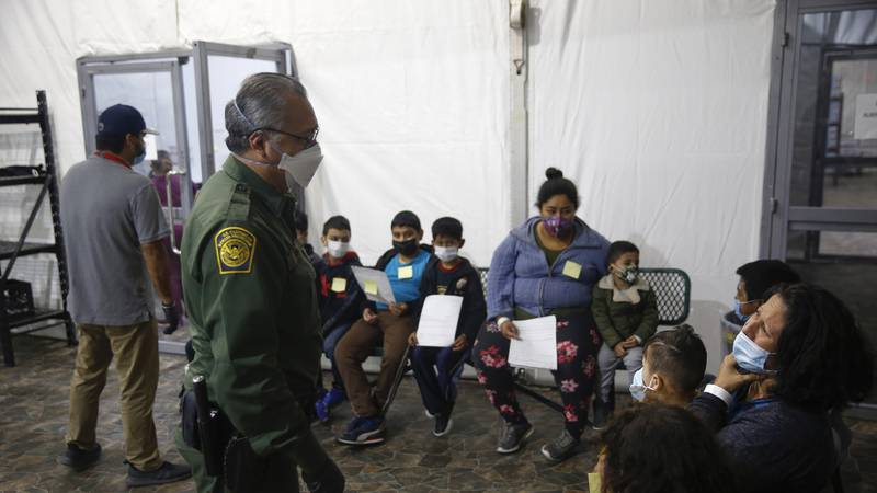 Migrants are processed at the intake area of the U.S. Customs and Border Protection facility,...