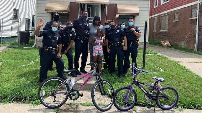 The officers of the Detroit Police Department's second precinct arranged to get each girl a new...