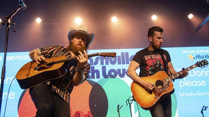 John Osborne, left, and TJ Osborne of Brothers Osborne perform at the To Nashville, With Love...