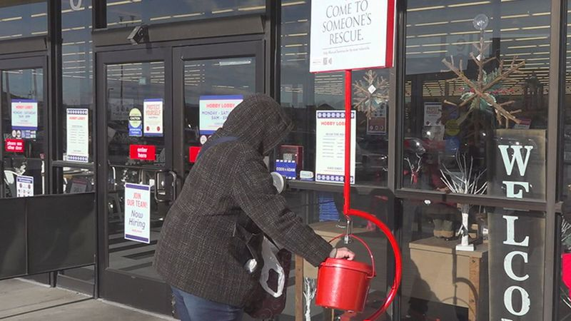 Community members are placing money in the red kettles.
