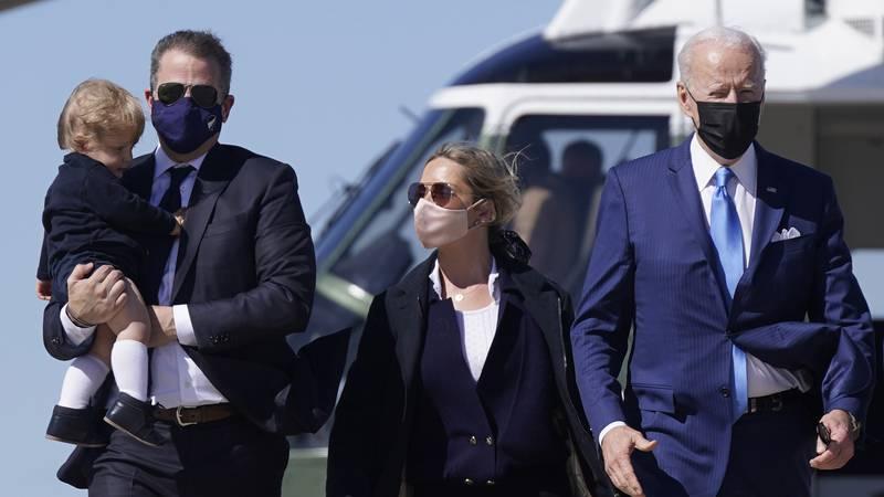 FILE - In this March 26, 2021, file photo President Joe Biden walks with his son Hunter Biden,...