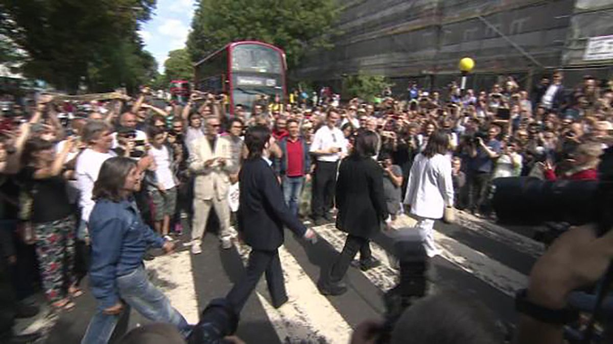 Fans of The Beatles swarmed Abbey Road in London for the 50th anniversary of the iconic photo. (CNN)