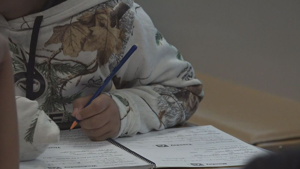 A students working on their schoolwork.