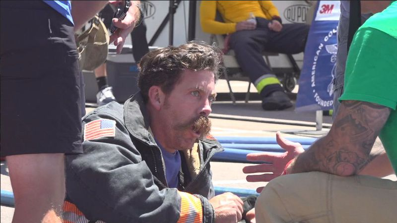 An exhausted firefighter after completing the course.