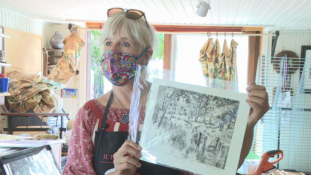 Artist Deborah Mitchell with a print she made of Grace Coolidge Creek using an old style...