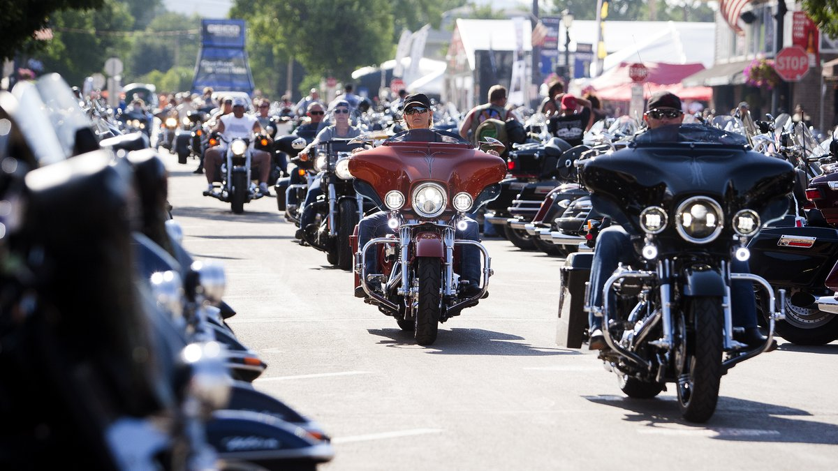 In this Aug. 5, 2016 file photo, bikers ride down Main Street in downtown Sturgis, S.D., before...