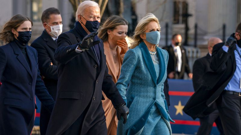 President Joe Biden and First Lady Jill Biden, walk near the White House during a Presidential...