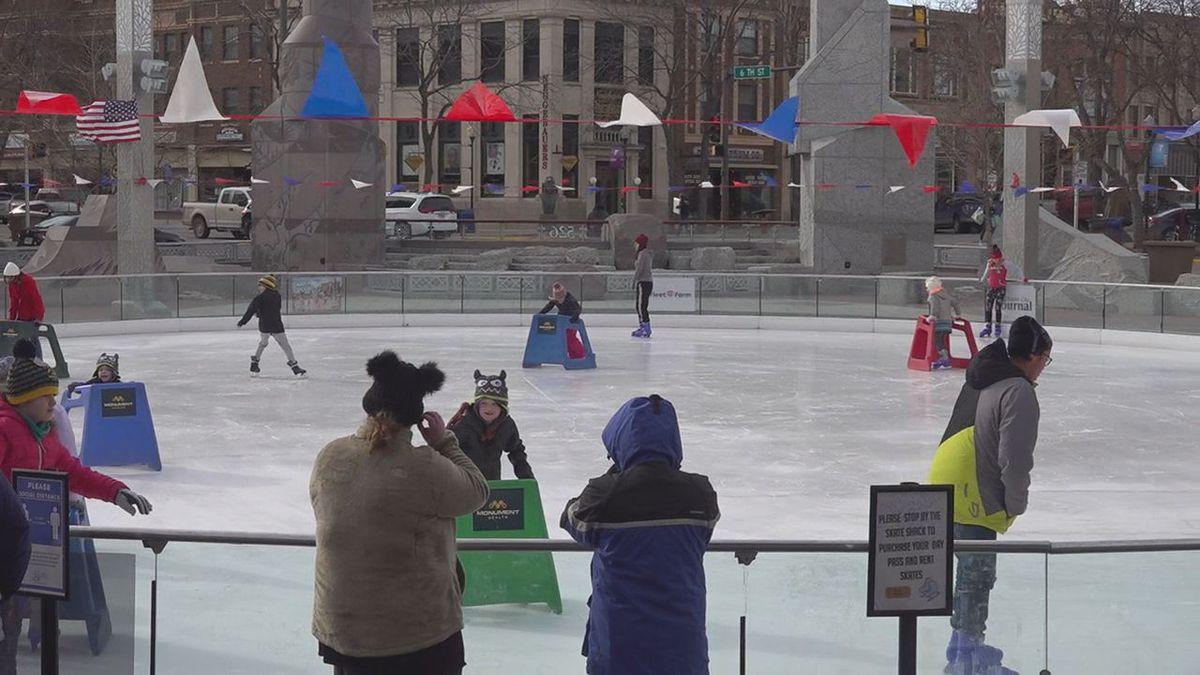 People ice skating.