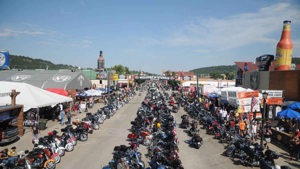 Motorcycles stretch down Main Street in Sturgis, S.D., on Wednesday, Aug. 5, 2015, for the...