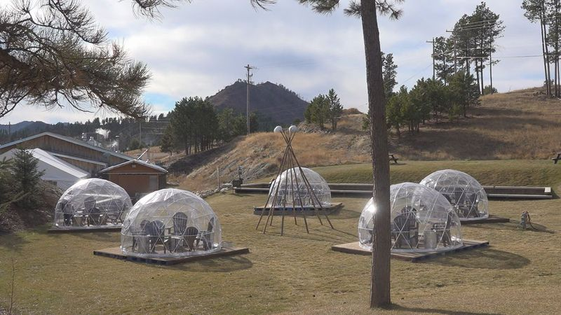 The taproom and winery set up five plastic igloos on their concert lawn, which lets customers...