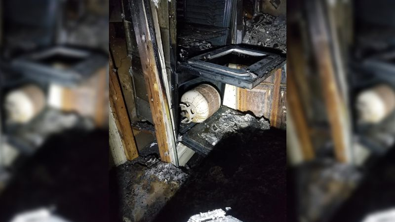 An unexploded 25-pound propane tank sits sideways in the oven of an actively-used church in...